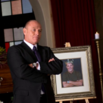 CORBIN BERNSEN eulogizes BERNIE (Chris Mulkey), the 'Kool King of Air-Conditioning'.
