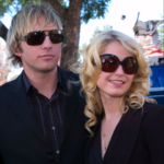RUSSELL (Ryan Hansen) and REBECCA (Whitney Able) attend their cousin's funeral.